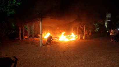ARCHIVE PHOTO: A vehicle and the surrounding area are engulfed in flames after it was set on fire inside the US consulate compound in Benghazi late on September 11, 2012 (AFP Photo)