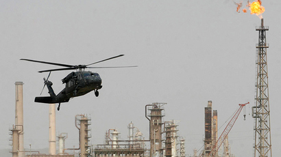 ARCHIVE PHOTO: A U.S. helicopter lands at the oil refinery in Baiji, 180 km (112 miles) north of Baghdad February 25, 2009 (Reuters / Sabah al-Bazee)
