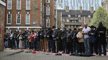 Muslims attend Friday prayers in the courtyard of a housing estate next to the small BBC community centre and mosque in east London March 28, 2014. (Reuters/Stefan Wermuth)
