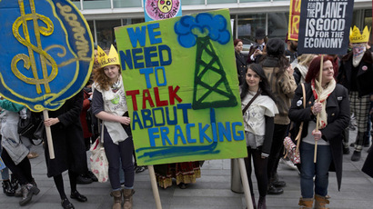 Demonstrators hold banners during an anti-fracking protest in central London March 19, 2014. (Reuters/Neil Hall)