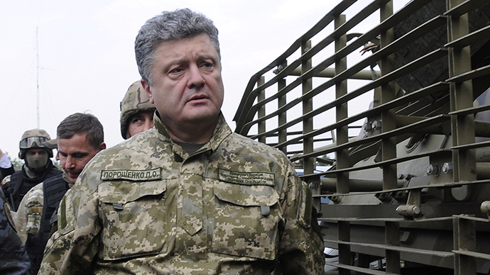 Ukraine's President Petro Poroshenko walks at the military camp near the town of Svyatogorsk in Eastern Ukraine, June 20, 2014. (Reuters)