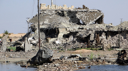 A picture taken on June 21, 2014 in the city of Ramadi, west of the capital Baghdad shows a building that was damaged during the fightings between the Sunni anti-Al-Qaeda militia Sahwa (Awakening) and anti-government militants, including from the jihadist Islamic State of Iraq and the Levant (ISIL) in the Anbar province (AFP Photo / STR)