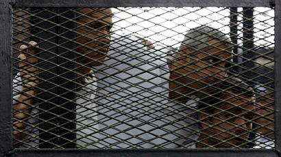 Peter Greste, Mohamed Fahmy and Baher Mohamed (L to R), listen to the ruling at a court in Cairo June 23, 2014 (Reuters / Asmaa Waguih)
