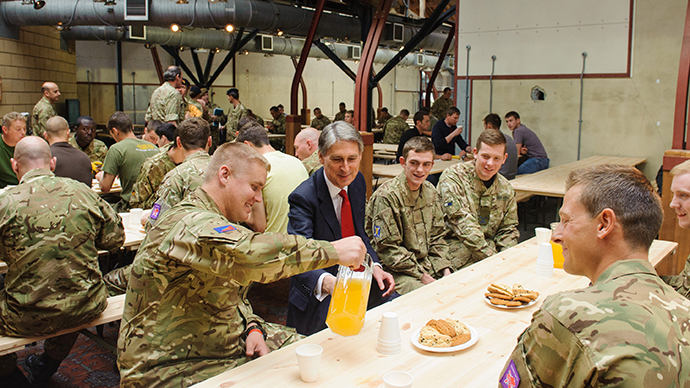 Defence Secretary Philip Hammond speaks to troops during a visit to the temporary Army barracks at Tobacco Dock, a former shopping centre in east London (Reuters)