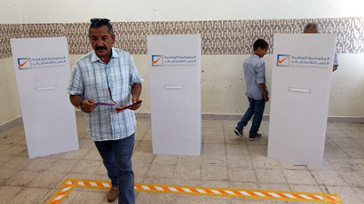 Libyans vote in legislative elections for choosing 200 members of the General National Congress, or parliament, at a polling station in the eastern city of Benghazi on June 25, 2014. (AFP Photo / Abdullah Doma)