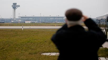 A journalist photographs the construction site of the Berlin Brandenburg international airport Willy Brandt (BER) in Schoenefeld (Reuters / Fabrizio Bensch)