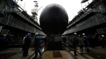 "People attend a ceremony launching the diesel-electric submarine ""Rostov-on-Don"" at the Admiralty Shipyards in St. Petersburg, June 26, 2014 (Reuters / Alexander Demianchuk)"