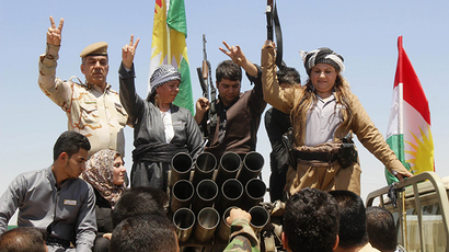Members of the Kurdish Peshmerga celebrate in the city of Kirkuk June 24, 2014. (Reuters / Ako Rasheed)