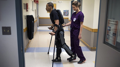 Samuels walks with a ReWalk electric powered exoskeletal suit during a therapy session with Voigt at the Mount Sinai Medical Center in New York City (Reuters / Mike Segar)