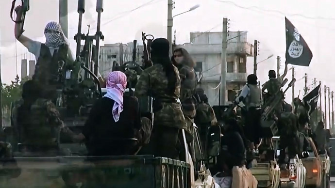 An image grab taken from a propaganda video released on March 17, 2014 by the Islamic State of Iraq and the Levant's al-Furqan Media allegedly shows ISIS fighters driving on a street in the northern Syrian City of Homs. (AFP Photo)