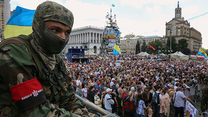A member of the Ukrainian far-right radical group Right Sector looks on during a protest at Independence Square in Kiev June 29, 2014. (Reuters / Konstantin Grishin)