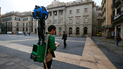 A man takes pictures with a Google Street View Camera in Plaza Sant Jaume in front of the town hall of Barcelona (Reuters / Gustau Nacarino)