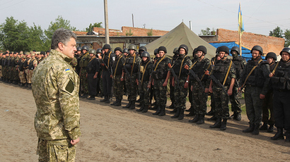 Ukraine's President Petro Poroshenko greets servicemen at the military camp near the town of Svyatogorsk in Eastern Ukraine, June 20, 2014 (Reuters / Mykhailo Markiv)