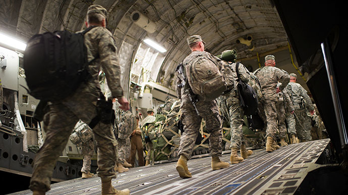 US soldiers board the last C17 aircraft carrying US troops out of Iraq at Camp Adder on the outskirts of the southern Iraqi city of Nasiriyah on December 17, 2011. (AFP Photo / Martin Bureau)