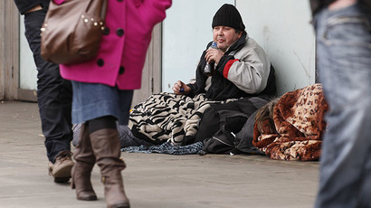 A homeless man sits on the pavement, in central London (Reuters / Suzanne Plunkett)