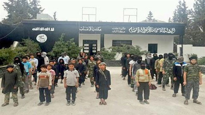 "Published photo of young boys lined up in front of a ""membership office"" for ISIL, in the Syrian town of Al-Bab."