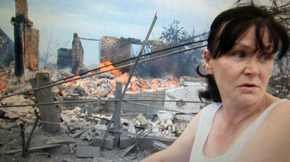 A local resident at the scene of the village of Kondrashovka, destroyed by Kiev troops (Still from RT video)