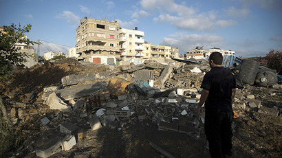 Palestinian man inspects damage following an overnight Israeli air strike, on July 3, 2014 in Gaza City. (AFP Photo / Mohammed Abed) (RT's video shows airstrikes in Gaza Strip)