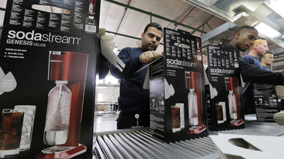 Employees pack boxes of the SodaStream product at the factory in the West Bank Jewish settlement of Maale Adumim January 28, 2014. (Reuters/Ammar Awad)