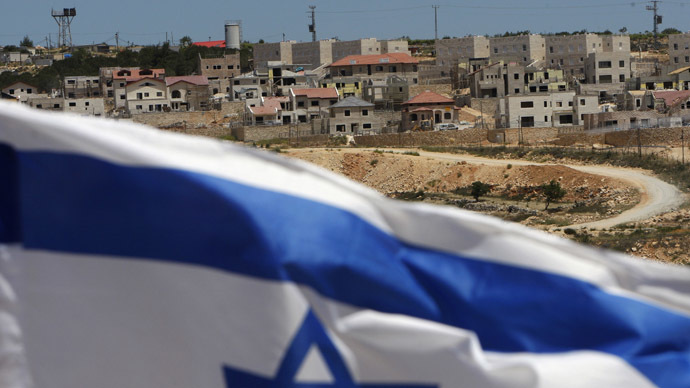 An Israeli flag waves on a hill near the West Bank Jewish settlement of Elazar, in the Etzion settlement bloc near Bethlehem (Reuters/Ronen Zvulun)