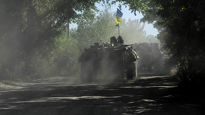 A hand out picture taken on June 3, 2014 and released by the Prime Minister Press Service displays an  APC of the Ukrainian forces moving some 20 km from the eastern Ukrainian city of Slavyansk. (AFP Photo)