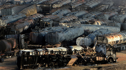 Burned-out fuel trucks are seen following an overnight attack by Taliban militants in Chawk-e-Arghandi on outskirts of the Afghan capital Kabul on July 5, 2014. (AFP Photo / Wakil Kohsar)