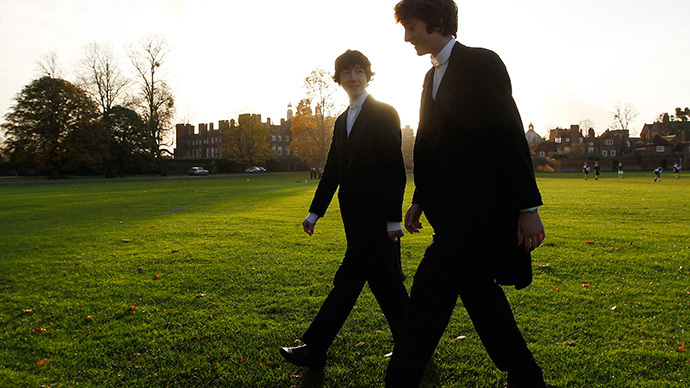 Boys from Eton college walk across their playing fields in Eton, southern England (Reuters / Eddie Keogh)