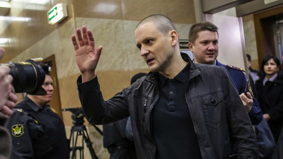 Opposition activist Sergey Udaltsov charged with mass riots conspiracy is seen here in Moscow City Court which holds a merits hearing of Udaltsov and Razvozzhayev's criminal case. (RIA Novosti/Andrey Stenin)