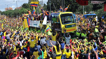 A crowd of Colombian fans greet their national football team upon their arrival in Bogota after the FIFA World Cup Brazil 2014, on July 6, 2014.(AFP Photo / Guillermo Legaria)
