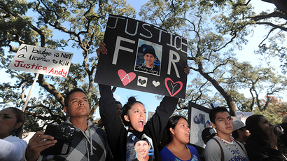 ARCHIVE PHOTO: Vanessa Lopez, 15, holds a placard (in black) as she joins hundreds of protesters at Santa Rosa Junior College demanding justice for Andy Lopez Cruz in Santa Rosa, California October 29, 2013 (Reuters / Noah Berger)