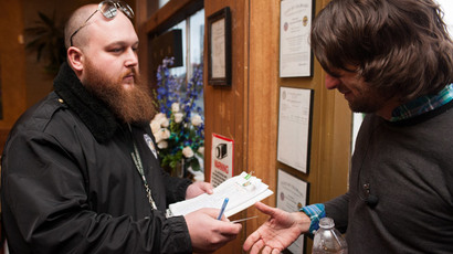 Head of security Kurt Britz (L) checks the driver's license of Adam Hartle of Jacksonville, Florida at the 3-D Denver Discrete Dispensary on January 1, 2014 in Denver.(AFP Photo / Theo Stroomer)