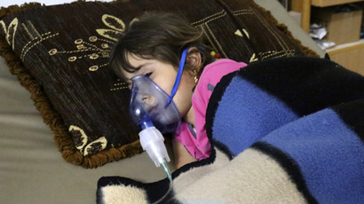 A girl, affected by what activists say was a gas attack, receives treatment inside a makeshift hospital in Kfar Zeita village in the central province of Hama May 22, 2014. (Reuters/Badi Khlif)
