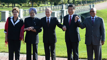President of the Federative Republic of Brazil Dilma Vana Rousseff, Prime Minister of the Republic of India Manmohan Singh, second left, President of the Russian Federation Vladimir Putin, President of the People's Republic of China Xi Jinping and President of the Republic of South Africa Jacob Zuma, from left, pose for group photographs. (RIA Novosti)