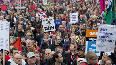 Demonstrators listen to speakers in Hyde Park at the end of a protest march organised by the Trades Union Congress (TUC), in central London October 20, 2012. (Reuters/Neil Hall)