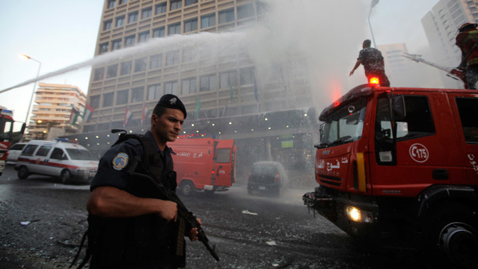 A policeman secures the area as firefighters put out a fire at Duroy hotel following a bomb attack in Raouche, in western Beirut June 25, 2014.(Reuters / Mahmoud Kheir)
