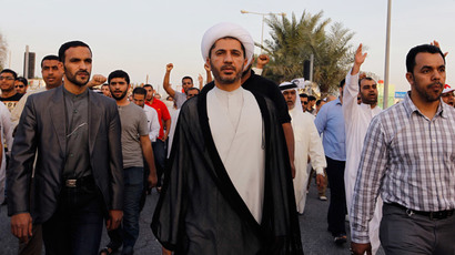 General Secretary of Al-Wefaq, Ali Salman (C), walks as protesters behind him shout anti-government slogans during a rally organized by Bahrain's main opposition party Al Wefaq in Budaiya, west of Manama, December 13, 2013. (Reuters / Hamad I Mohammed)