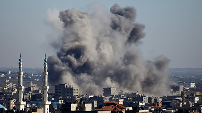 Smoke billows from buildings following an Israeli air strike in Gaza City on July 11, 2014. (AFP Photo / Mohammed Othman)