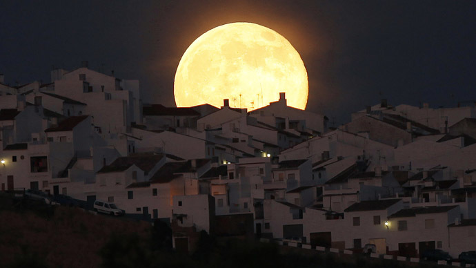 The Supermoon rises over houses in Olvera, in the southern Spanish province of Cadiz, July 12, 2014. (Reuters/Jon Nazca)