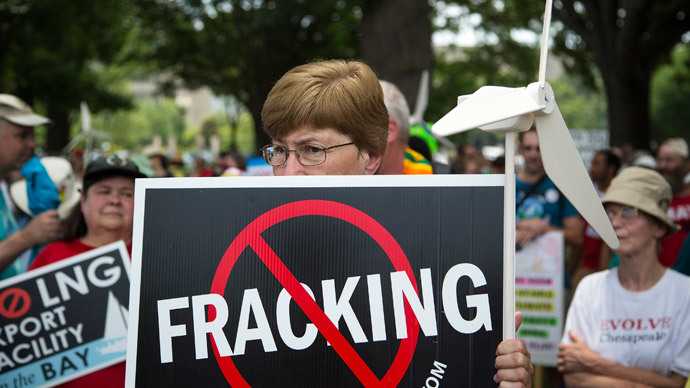 Protesters take part in a rally against U.S. fracked gas exports from the proposed Cove Point facility in Maryland, at a demonstration by several environmental organizations and activists, at the National Mall in Washington July 13, 2014.(Reuters / Jonathan Ernst)