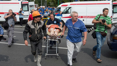 Rescuers and paramedics evacuate passengers injured as several subway cars derailed in Moscow, on July 15, 2014. (AFP Photo / Dmitry Serebryakov)