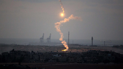 A photo taken on July 15, 2014 from the southern Israeli Gaza border shows Israeli army flares falling into the Palestinian enclave. (AFP Photo / Menahem Kahana)