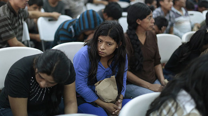 Guatemalan illegal immigrants deported from the U.S. wait for their turn to be processed for re-entry at La Aurora airport in Guatemala City July 15, 2014. (Reuters / Jorge Lopez)