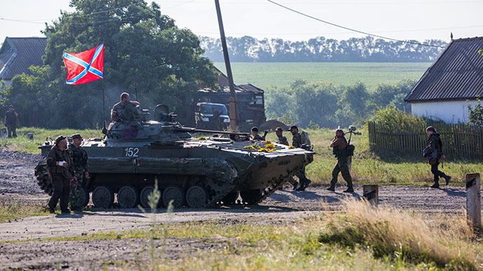 People's militia soldiers in the occupied village of Marinovka, near the town of Snezhnoye. (RIA Novosti / Andrey Stenin)