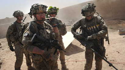 In this photo taken on August 5, 2011, US troops patrols Kandalay village following Taliban attacks. (AFP Photo / Romeo Gacad)