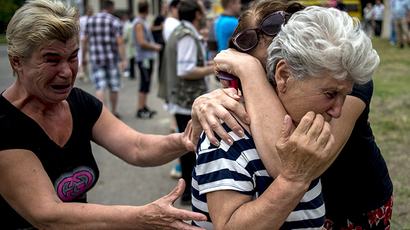 People in Lugansk after an artillery attack on July 18, 2014. (RIA Novosti / Valeriy Melnikov)