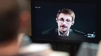 US National Security Agency (NSA) whistleblower Edward Snowden speaks to European officials via videoconference. (AFP Photo / Frederick Florin)