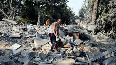 A Palestinian searches for belongings amongst the rubble of a house which police said was destroyed in an Israeli air strike in Rafah in the southern Gaza Strip July 20, 2014. (Reuters / Ibraheem Abu Mustafa)