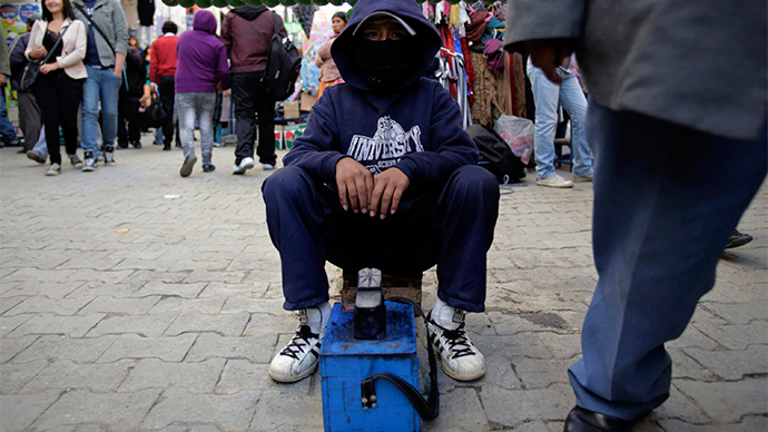 A boy working as a shoe shiner is seen in La Paz (Reuters / David Mercado)