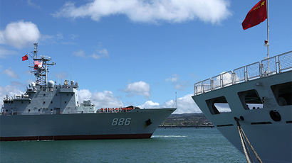 The Chinese People's Liberation Army (PLA) Navy replenishment ship Qiandaohu (866) (L) sails past the PLA Navy hospital ship, Peace Ark, as it docks at the Joint Base Pearl Harbor Hickam to participate in the multi-national military exercise RIMPAC 2014, in Honolulu, Hawaii, June 24, 2014 (Reuters / Hugh Gentry)