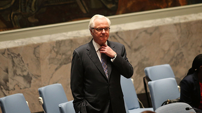 Russian Ambassador to the United Nations Vitaly Churkin (Right) pauses before voting for a United Nations Security Council draft resolution demanding full access for investigators at the Malaysia Airlines jet crash site in eastern Ukraine during a meeting of the Council to discuss the shooting down of jet on July 21, 2014 in New York City (AFP Photo /  Spencer Platt)